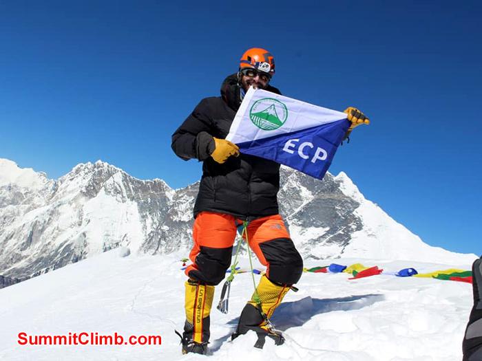 team member showing flag
