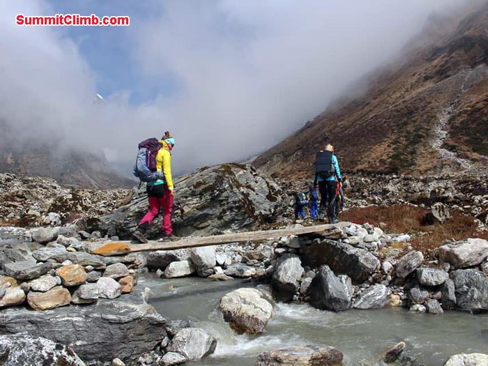 team members crossing bridge