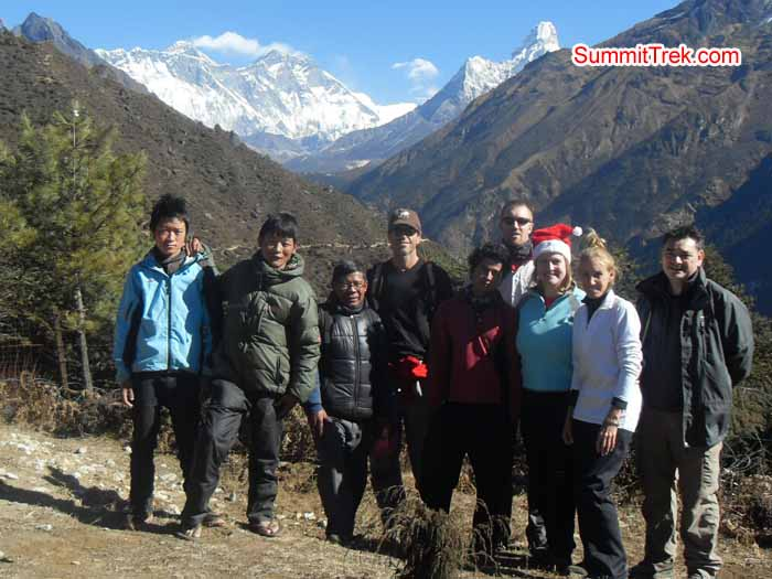 Team posing for photo just 15 minutes way from Namche Bazaar with the view of Everest, Lhotse and AmaDablam. Photo Kaji Tamang.