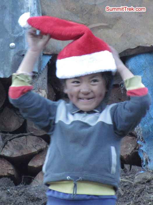 Small kid enjoying the christmas cap. Photo Aless