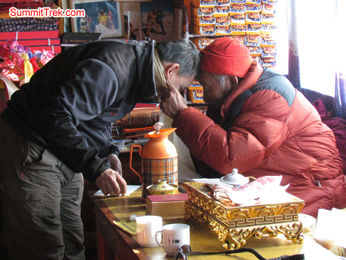 Henri getting bless from Pangboche Lama. Photo Aless