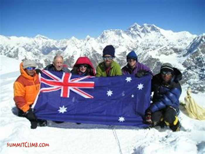 Our team on the summit of Mera Peak: Rajan Thapa (trek leader), Stuart Murray (climb leader), Kristen Murray (Stuart's daughter), Gary (Ferro) Ferris, Mark Garrett, and Tashi Sherpa (climbing sherpa). In the background from left to right: Cho Oyu, Pumori, Ama Dablam, Everest, and Lhotse