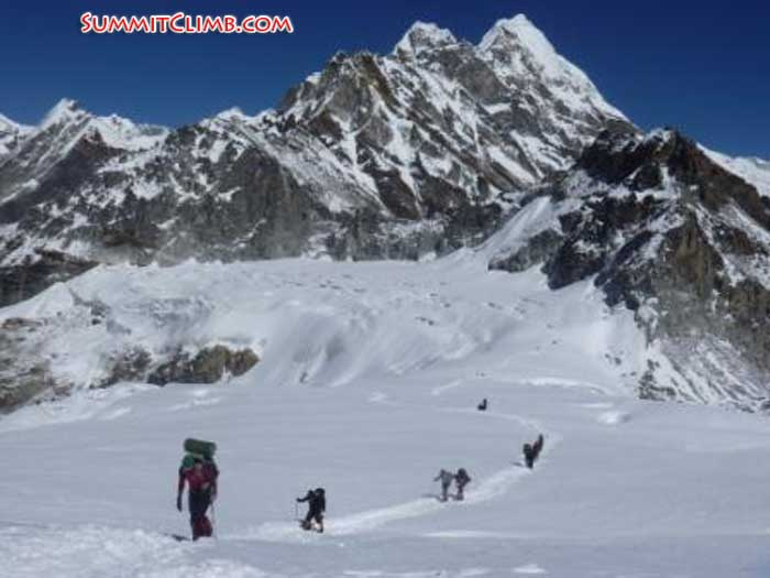 Team walking up to Mera Peak High Camp, Everest, Lhotse, and Nuptse in background