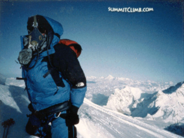 Daniel Mazur on the summit of Everest, after climbing it from the Nepal side. Don't forget to take off YOUR oxygen mask for the photo, when YOU reach the summit. Makalu and Kangchenjunga in the background