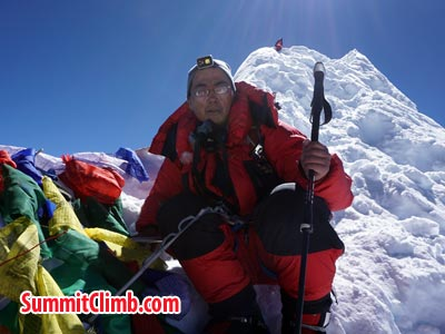 Puwei L. at the summit of Manaslu