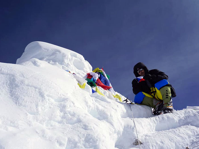 member at the summit of manaslu