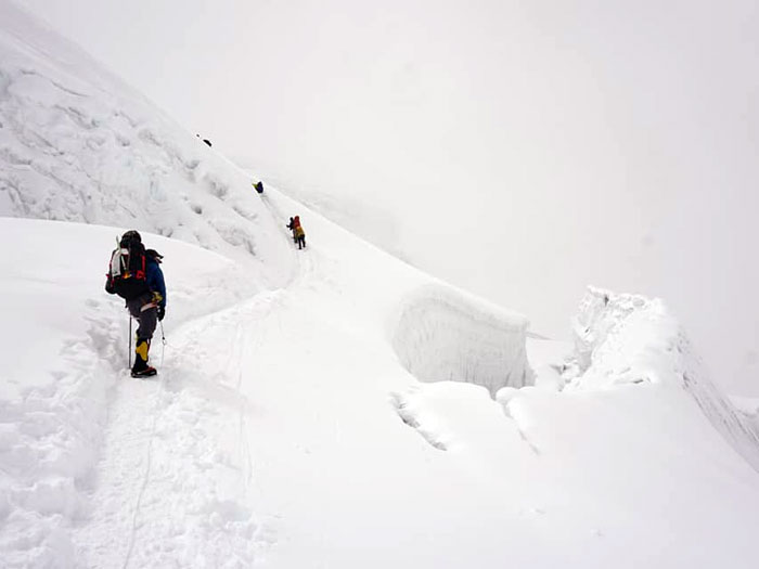 members climbing up to high camp