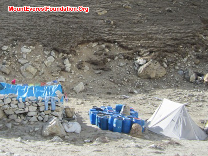 Porters shelter with blue barrels of waste.