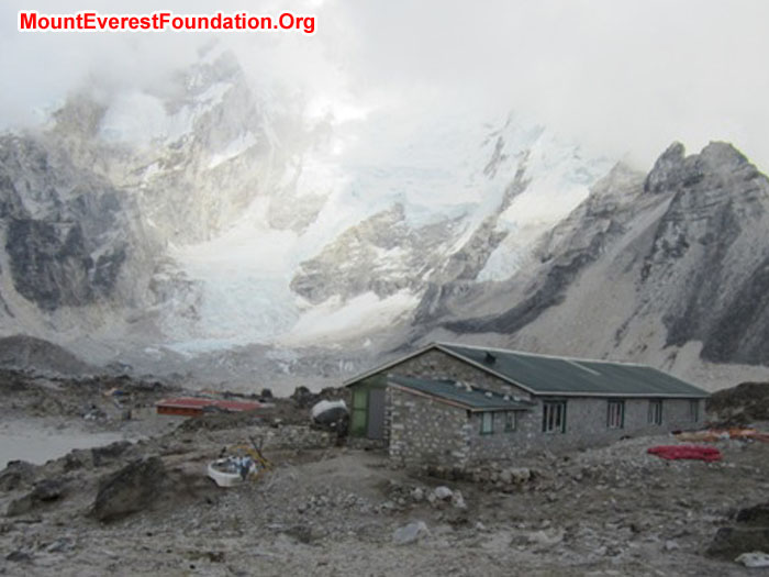 The main porters' shelter, with the red roofs of Gorak Shep in the back.  Our site is just to the left.