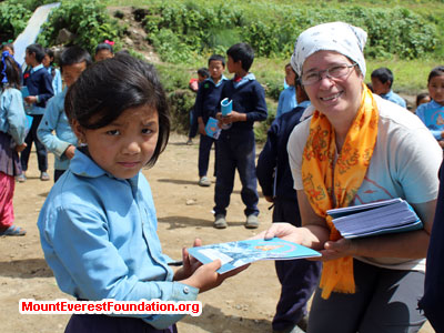 nepal volunteer trek, student receving donation
