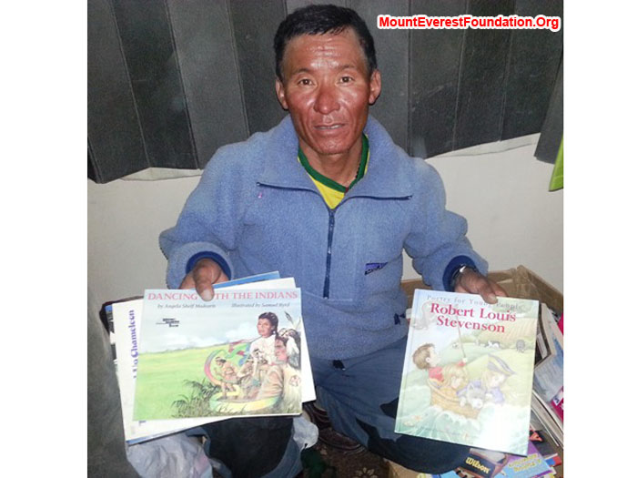 Jangbu Sherpa, Mount Everest Foundation, packing children's books for the service trek kindly donated by Carmen McMillan Nelon from Fort Worth, Texas. photo by Deha Shrestha.