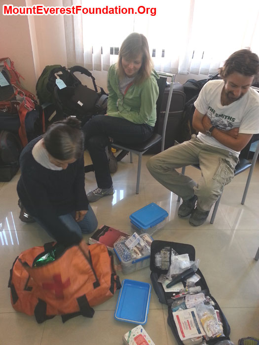 Marie (France), Daniela (Canada), and Jeremy (Australia) sorting medicines for the service trek. Photo by Deha Shrestha