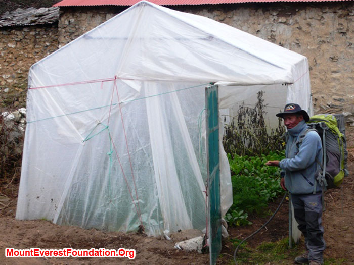 Jangbu Sherpa showing off the greenhouse, containing spinach, carrots, and tomatoes. Thanks to Marcia Macdonald and friends.
