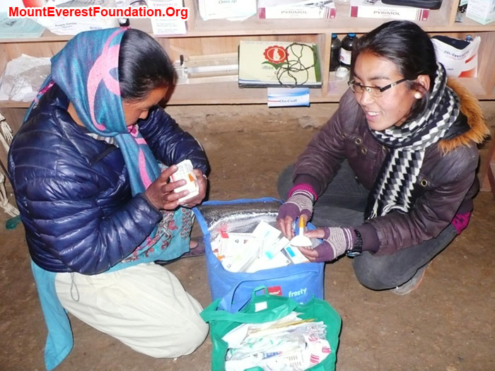 Pasi and Dati Sherpa examining medicines donated by Laurel and Paul Brophy and Paul Quinney from Mater Hospital, Rockhampton, Australia.