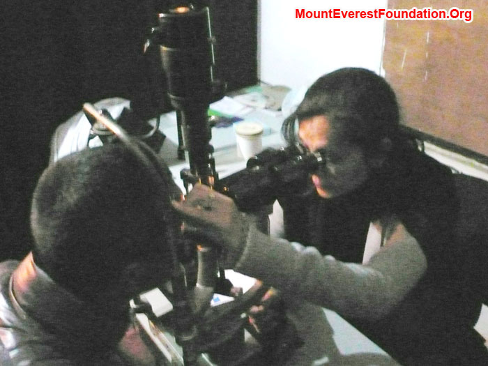 Eye surgeon examining Purba Sherpa