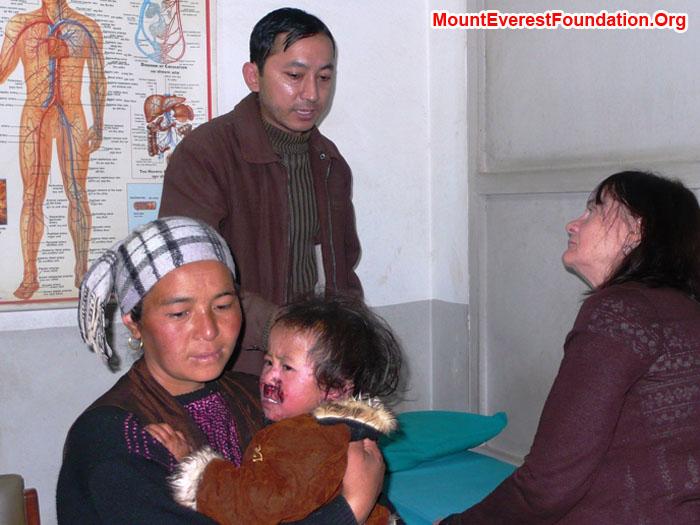 Hamu Sherpa, Nimke Sherpa, Dermatologist Rajendra, and Nurse Practitioner Shelley Bloom at Helping Hands Hospital.