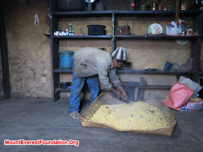 Farmer drying up Corn flower. Photo Daniela Milea