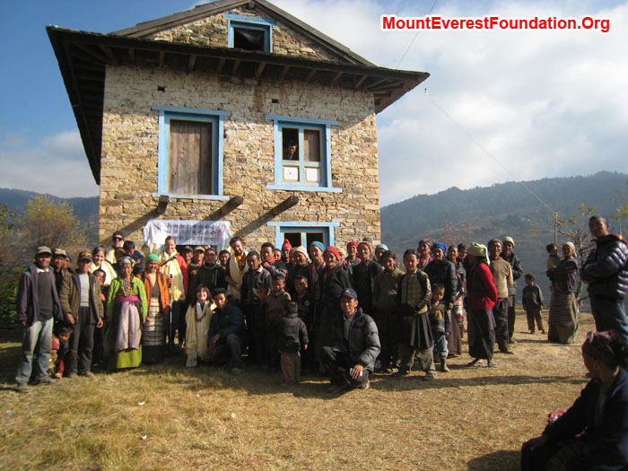 Villagers and service trek members in front of new health post bought by Mount Everest Foundation. Thanks to Mitch Lewsi, Juniper Foundation, Erik Petersen, Equator Adventures and Katherine Peacock, Jonathan Peacock Memorial Fund. Photo by Marie