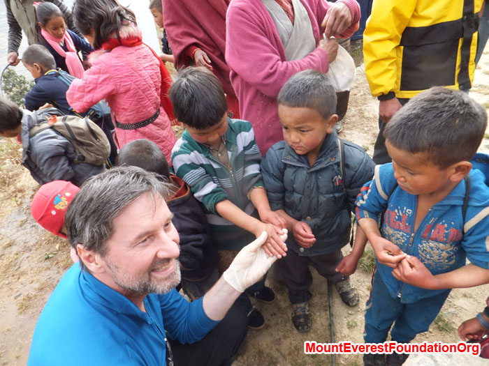 Wolfgang Nicola shows Dhorkharka students how to wash their hands. Photo by Dan Mazur