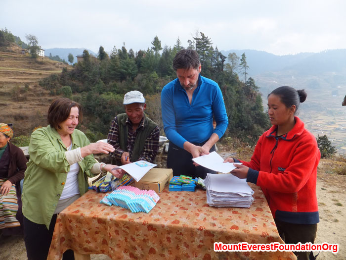 Anne Kates, Jangbu Sherpa, Wolfgang Nicola, and Yangjie Sherpa organizing school supplies before distributing to all local students. Photo by Dan Mazur